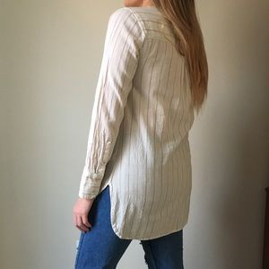 Half buttoned, long sleeved top.